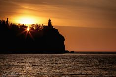 Sunrise over the ridge at the Split Rock Lighthouse in Two Harbors.  by John Lombardi