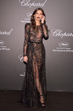 The Best Celebrity Style From Cannes Film Festival 2017: Cannes Film Festival known for princess-like gowns and sexy, thigh-high slits, and this year, there's more of the same—with even more pouf and revealing details. -- Sara Sampaio in lacy sheer black dress | coveteur.com