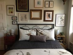Nicely displayed frames over and around the bed.