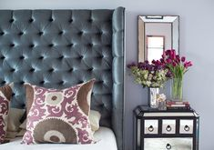 tufted headboard and mirrored bedside table