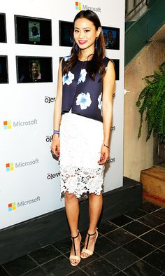 Jamie Chung in a floral print top + lace pencil skirt