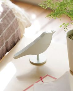 "Bird alarm clock ""wakes you up comfortably in the morning with birdsongs"".  But if it is too comfortable, will it wake up anyone?"