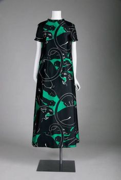 "Evening Dress, Valentino (1932-) for the Marshall Field & Company, Italy: 1967, printed silk, rhinestones. ""It is not a mere coincidence that Valentino printed this evening gown with black panthers in 1968. Social change has never influenced fashion more so than it did in the 1960s. The feminists, civil rights and environmental movements of the 1960s as well as the War in Vietnam greatly affected clothing well into the 1970s."""