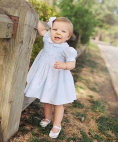 Who can resist a baby girl in blue?! Margaret is picture perfect in her Mommy's 31 year old Feltman Brothers dress for her one year photos! What a dolly!  https://feltmanbrothers.com