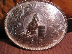 BIG-FANCY-Barrel-Racing-TROPHY-Silver-Plate-Cowboy-BELT-BUCKLE-$135 or MAKE-OFFER We are OLDWEST on eBay and have over 1200 vintage belt buckles listed us. Here is the link: http://stores.ebay.com/OWN-A-PIECE-OF-THE-OLDWEST E-Mail us at saddlerestoration@hotmail.com