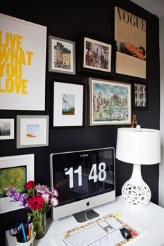 Definitely a home office space I will model my own after. Love the dark wall with the bright artwork.