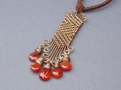 rustic bronze woven chevron boho pendant by BronzeAge Jewelry  Length of Pendant: 4 1/2 inches Width of Pendant: 5/8 inch