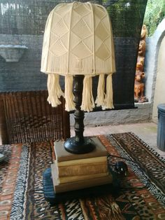 Upcycled book lamp, from old painted books, Annie Sloan chalk paints, and thrift store lampshade. Love this.