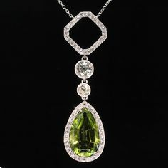 Platinum necklace art deco diamond pendant with pear shape peridot (ca.1920). Platinum necklace Art Deco diamond pendant with pear shape peridot