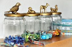 Plastic animals glued on the lid, and then spray painted gold.