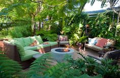 Lush tropical and drought-tolerant plants (bromeliads, orchids & tree ferns) enclose the space. Landscape design by homeowner and Greentree Landscaping.  VENICE CA