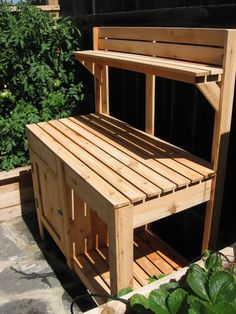 Potting bench - Out on the balcony, makes it less messy while handling potting soil.
