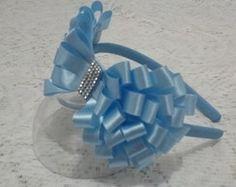 Tiara Laço Azul                                                                                                                                                                                 Mais