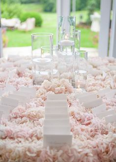 The seating cards are displayed on fresh pink hydrangeas. And yes, the room is smells like heaven.