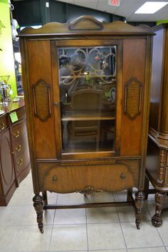 """Vintage Walnut China Cabinet on Casters - Glass Door with Fretwork Opens to 2 Fixed Shelves with Double Plate Grooves - 1 Lower Dovetailed Drawer - """"Simpsons Furniture Ltd."""" - 34.5"""" W x 14.5"""" D x 65.5"""" H"""