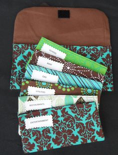 Cash BUDGET SYSTEM, Cash Envelopes, Carrier and Coin velcro pouch-Brown & Turquoise Damask (it can be used with the Dave Ramsey System). $43.99, via Etsy.