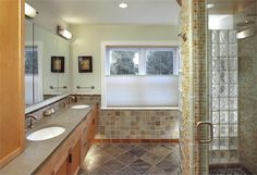 The en suite bathroom incorporates beautiful, sustainable materials including a shower for two fitted with glass block and recycled glass tile.