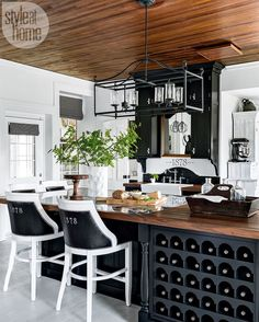 "1,672 Likes, 24 Comments - Style at Home (@styleathome) on Instagram: ""Eye-catching elements like the oversized pendant light, built-in wine storage and nailhead-trim…"""