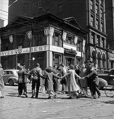 Victory in Europe Day celebrations at King and Bay streets, Toronto, 8 May 1945.