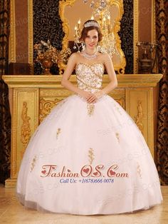 Elegant White Quinceanera Dress Sweetheart Tulle Appliques Ball Gown  http://www.fashionos.com  If you're inclined to add a little shine to your quinceanera , this quinceanera dress is the best choice! The strapless bodice with lace-up back highlighted with full dazzling applique and beadwork , which creats a flattering shape.the full skirt is accented with the scattered beaded floral embroidery appliques added a uinque look. This shimmering Quinceanera gown can seize your big day!