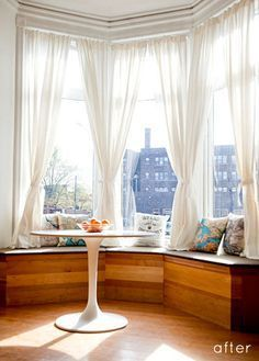 """Bay windows are nice, but often there's a an """"old"""" feeling to them. This simple bench makes it look modern yet welcoming at the same time. Would love to have a condo!!"""