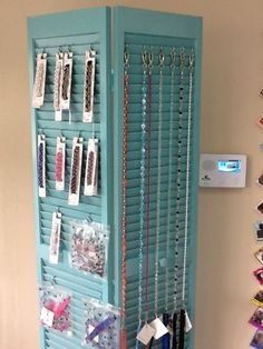 Old bi-fold closet door used to display product in dog grooming salon/boutique-Trinity I have a couple of these! Pet Shop, Dog Grooming Shop, Dog Grooming Salons, Dog Grooming Business, Boutique Interior, Pet Boutique, Boutique Ideas, Dog Salon, Dog Store