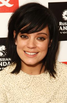 Really cute shoulder length haircut with bangs.