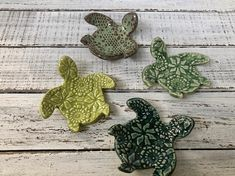 These are just so cool! They look like baby sea turtles. You can use them as a coffee spoon rest by your coffee pot, tea bag rest, jewelry dish, tea light/ votive candle holder, trinket dish and so much more Hand built with white clay, textured with antique lace and glazed deep