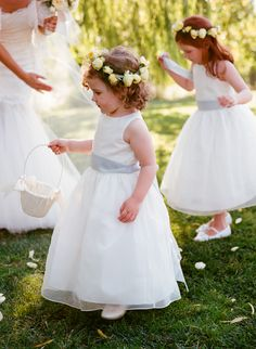 White flower girl dresses with lavender sashes.  Fresh floral  crown for flower girls.  Photo by Meg Smith.