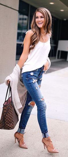 #fall #outfits women's white spaghetti strap shirt and pair of tattered blue jeans
