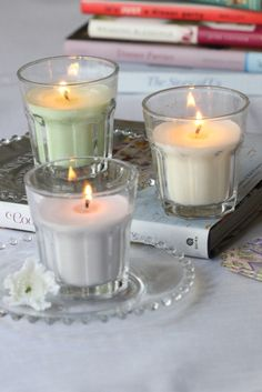 DIY Candles in Drinking Glasses. Would be a nice idea to mix the glasses up by buying assorted ones from the thrift shop!