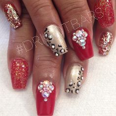 I love cheetah but I would switch that nail out other than that it looks great love pinkish red colors