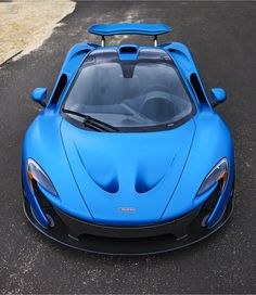 McLaren P1 painted in Satin Cerulean Blue w/ exposed Carbon Fiber  Photo taken by: @drivingforceclub on Instagram