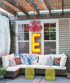 Outdoor Porch Backyard Idea - Minus that obnoxious glowing sign, and plus some cute fairy lights