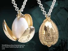 Treasures Inspired By The World Of Harry Potter - The Golden Egg Pendant - Miniature Golden Egg with petals that bloom open. Gold plated pendant comes complete with chain and wood display box.