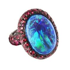 """Australian jeweler Katherine Jetter's opal Scarlett Ring has pave rubies surrounding a stunning bezel-set boulder opal in electric blue. Her preferred stone is the opal, and one of the aims of her work is to champion this beautiful Australian gemstone."""