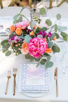 Colorful peony + ranunculus floral centerpiece: http://www.stylemepretty.com/california-weddings/carmel-valley/2015/11/25/rustic-romantic-holman-ranch-wedding/ | Photography: Jasmine Lee - http://jasmineleephotography.com/index3/