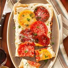 Grilled Cheese & Tomato Flatbreads Recipe -This is a combination of grilled pizza and a cheesy flatbread recipe I discovered years ago. It's a great appetizer or main dish. —Tina Repak Mirilovich, Johnstown, Pennsylvania