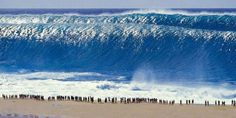 tsunami wave. Good God, Look at ALL of the people on the edge of the sea!