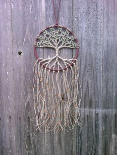Macrame wall hanging made with natural hemp and glass beads. This tapestry is great for the bohemian home!