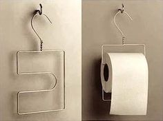 diy toilet paper holder with a coat hanger;  i had a hard time finding solid wall or studs in my bathroom, but all this needs is a cup hook!