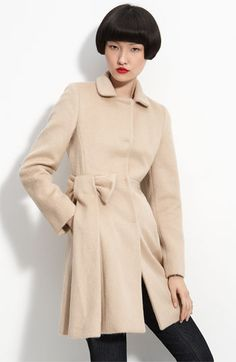 A slightly different and feminine style for a camel coat.  This will go with ANY color.