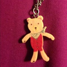 Teddy bear necklace From XXI, a small cute teddy bear necklace on a adjustable medium length chain. The bear charm is wood with paint and a protective coating. No chips or wear on it. Forever 21 Jewelry Necklaces