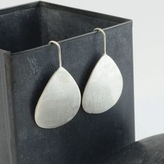 Large petal earrings in sterling silver.....very simple and very striking! $140 http://www.crowdedsilver.com.au/store/large-petal-earrings-p-21460.html #earrings