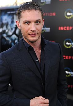 Tom Hardy. hot damn, butter him up and serve him to me warm...he is delicious