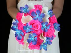 Maritza Wedding Flower Package Artificial wedding flowers. Bridal bouquet with neon pink roses and real touch white calla lilies and blue orchids.