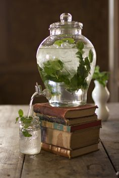 glass teardrop drink dispenser  $55.00--A perfect way to serve those flavored waters I love to have during the summer.