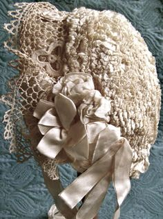 antique Irish crochet baby bonnet with silk ribbons ... ca. 1910. From Antique Delights on Etsy