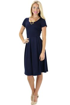 A simple and classic dress the Ivy is perfect for bridesmaids, date night or going to church! Dress it up or down with your accessories and shoes!  Ivy Modest Dress in Navy Blue