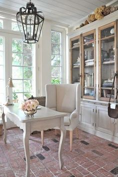 A buffet on the dining room side of foyer wall created with bookshelves.
